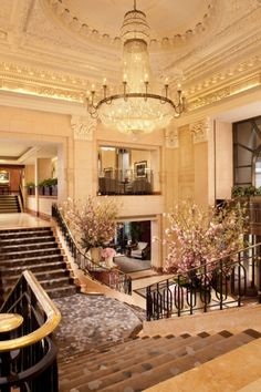 My luxury home: Grand staircases coming down from both sides of the room and joining in the center
