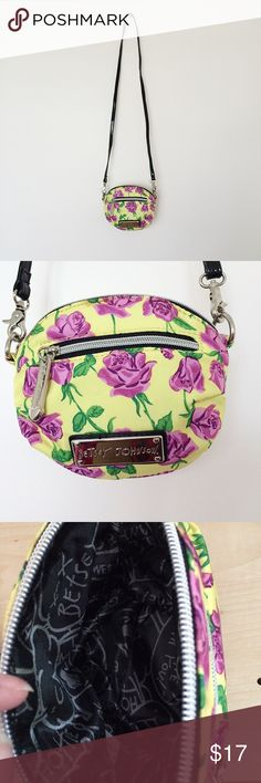 Betsey Johnson Crossbody Bag Betsey Johnson Crossbody Bag. Yellow with purple flower print. Exterior zippered pocket. Strap is detachable so you can also carry it as a clutch. I bought this off another site and it was listed as new, however there are three minor stains on it as shown in last photo. Not really that noticeable and I zoomed in on them for photo purposes. Selling because it does not have any interior pocket, not because of the stains. Otherwise it does look new and the seller…