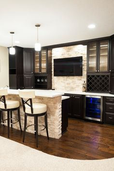 Basement Bar with Wood Flooring and Stone Wall contemporary-home-bar