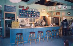 Not a house, but the interior of Luke's Diner from Gilmore Girls. I'd love to have a coffee shop some day, and have shelves to display the mugs like that. <3