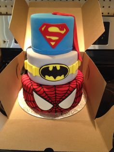 Superhero Cake Would have put Spider-man mask on top,  Superman chest in middle and Batman belt on bottom.