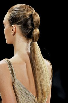 A super sleek pony at the Herve Leger S/S 2012 show.