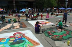 Chalk Walk 2016 on Main Street - July 9 & 10. This event draws thousands of people in the community to the heart of downtown Fort Wayne for artists and spectators alike to witness the transformation of Main Street into the colorful canvas of the city.