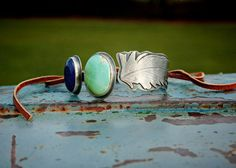 Turquoise Lapis and Sterling Silver Pressed Feather Bangle Cuff Bracelet with Tan Deer Leather Tie by jonesingforjewelry / bohemian / boho / gypsy / native american /  royston / american turquoise / handmade / artisan / artist / etsy / sterling silver / metalsmith / silversmith / craft / hand crafted / hand stamped / all good things are wild and free