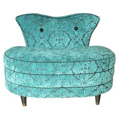 Vintage velvet pouf chair in Aqua.