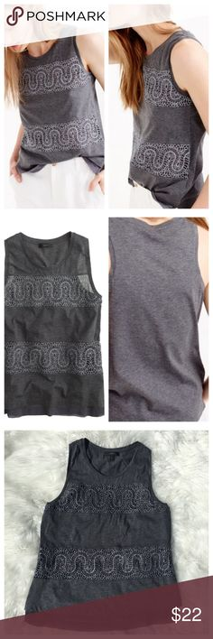 "J. Crew Grey Metallic  Lace Panel Tank Top --- S J. Crew Grey Metallic  Lace Panel Tank Top --- S --- ""our designers set out to create a dress up tank top you can wear to work but that doesn't feel out of place at the beach. Hence this cotton top, with panels of lace inspired by a vintage swatch."" --- semi sheer grey cotton main fabric, separated by two metallic lace panels backed with a sheer polyester --- the same sheer polyester peeks out at the bottom hem of the front of the tank…"