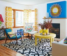 Give drab walls a clean coat of white and judiciously choose where to add color. In this living room, yellow and marine blue create a vibrant duo. The sunny yellow is cheery, but neutral enough to pair with the existing wood trim, while the blue is cool and refreshing. DIY It: Having trouble finding a super-large coffee table? We cut this dining table down to coffee-table height before coating it with a happy hue.