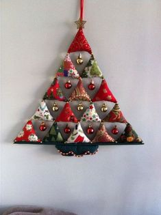 Very simple, 15 stuffed triangles with small baubles… Christmas tree decoration. Very simple, 15 stuffed triangles with small baubles hanging between. Quilted Christmas Ornaments, Fabric Christmas Trees, Small Christmas Trees, Felt Christmas, Homemade Christmas, Simple Christmas, Christmas Tree Decorations, Modern Christmas, Pallet Christmas
