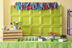 Simplest (and most awesome) idea for a party backdrop ever:  glue square paper plates to foam core board.