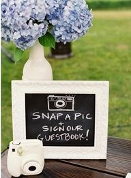 get a bunch of disposable cameras and one Polaroid so guest can take pictures to put with their comments.