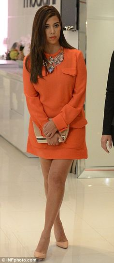 Kourtney Kardashian. Love the Orange outfit on her.