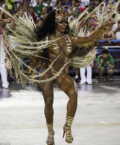 Mangueira samba school's drum queen Evelin performs during the carnival parade at the Sambadrome overnight