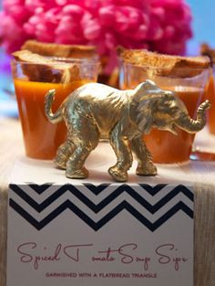 jewel tone exotic Moroccan Morocco theme sip and see baby shower blue chevron patterned menu cards with gold elephants
