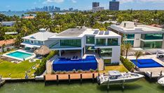 Inside a $15M Miami Home with a 12-Car Garage and Deep-Water Dock – Robb Report
