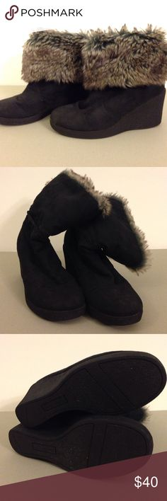 Black fur wedge boots Have it your way! Whether it is mainly a fur night or a simple black boot night. These are super warm but also has the cute factor. Very comfortable to walk in. I have had these for sometime, but have only worn them a handful of times. American Eagle Outfitters Shoes Heeled Boots