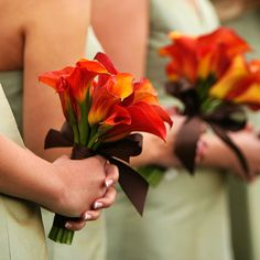 Small bouquets of fire calla lilies were perfect for the bridesmaids. The bold orange bouquet was wrapped in brown ribbon to incorporate the color scheme -- perfect complement to their green dresses.