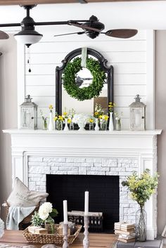 While hers is a faux fireplace, I like the wood planking and white brick.  LOVE...