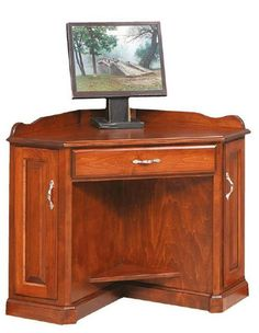Solid Wood Corner Computer Armoire Desk Elegant wood desk with formal style curves. Fits a corner perfectly with room for laptop and some storage to boot. Solid wood construction. Pick wood and stain and it is built to order in Amish country. #cornerdesk #desk #wooddesk #officefurniture