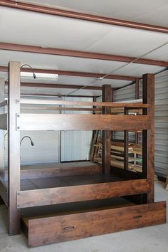 Custom Queen over Queen bunk bed, knotty alder construction, Gunstock finish. Bunk includes low voltage integrated lighting, and full trundle pullout. Delivered to Mendham, New Jersey.