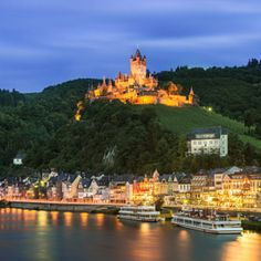Cochem- Location: Germany  Things to do: Located alongside the banks of the Moselle River, Cochem oozes with history. Step on the cobbled stone streets and back in time with the half-timbered houses, medieval festivals, and the famous Reichsburg castle. The castle overlooks the town from a hill and is over 1,000 years old.  Nearest city: Mayen-Koblenz