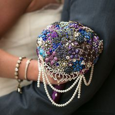 We love the bold colors and strands of pearls in this gorgeous brooch bouquet!