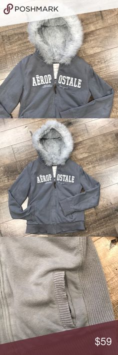 Aeropostale Faux Fur Jacket Excellent condition. True to size. Gray with ribbed sides for stretch. 2 pockets in the front. All material content in photo. No trades. Aeropostale Jackets & Coats