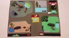 Zoo playmat featuring various habitats. Wool blend felt sewn onto medium weight canvas.