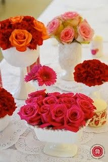 pink, red and orange roses in various milk glass containers, floral centerpiece, wedding centerpiece