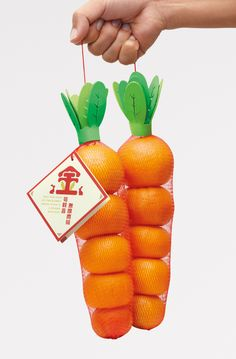 Mandarins packaged to look like carrots by siok yee koh. Don't get the reason for this, but would be nice to actually package carrots this way...