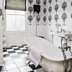 Black and white don't have to mean boring.  Checkerboard patterns and damask walls really make this bathroom pop.
