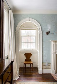 lovely architectural detailing and mouldings | Chinoiserie wallpaper | niche or dormer with arched opening | hurricane sconce | white linen drapes