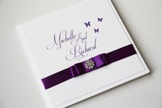 Cadbury purple invites with butterfly detail and gorgeous embellishment #weddings #Cadbury