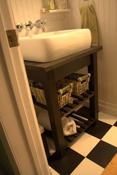 Bathroom vanity using a Bekvam kithen cart from Ikea...this is a good idea for the girls bathroom