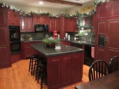 Helloooooo awesome kitchen! The color of the cabinets is perfect!