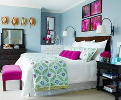 Vibrant and Fun Splashes of bright pink create a decidedly feminine vibe in this master bedroom. A group of four floral prints provide a bold focal point and contribute to the infusion of magenta throughout the space. A built-in dresser transforms a potentially unused corner into a convenient vanity area. Pretty and casual.