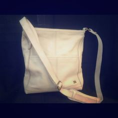 THE SAK cream leather cross body purse Genuine leather purse with fabric cross body strap (adjustable ) excellent condition . A few small flaws ,strap slightly dirty on the interior where touches shoulder.great interior . The Sak Bags Crossbody Bags