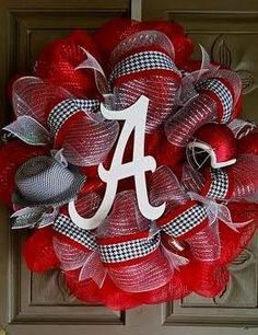 "This is a gorgeous 24"" Alabama deco mesh wreath made of red and white deco mesh and accented with houndstooth ribbon and a huge white hand painted script A with a houndstooth hat and Bama football hel"