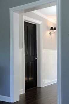 Kelly Baron - entrances/foyers - gray walls, gray wall color, hardwood floors, dark hardwood floors, black door, black, interior doors, crys...