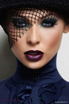Very balanced and well executed dramatic/evening makeup. I'm having a '90s flashback looking at this. Lol