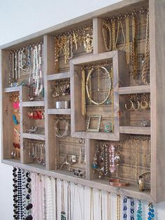 Organize your jewelry using this display case.  This earring holder is stained grey in color and made of pine wood.  This jewelry organizer display case can be used as an earring holder, necklace holder, bracelet holder, and ring holder.The display case measures: 32 inches wide 20 inches tall2 5/8 inches deepThere are 94 stainless steel hooks in various sized compartments and a removable piece of cork board for displaying post earrings.  Comes ready to hang and mounting screws are ...