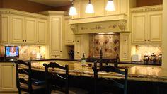 Beautiful Tuscan inspired kitchen by Maleno Development.