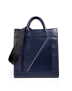 VIONNET Leather/Satin Tote in Indigo-Details Chic tonal satin paneling lends a ladylike look to this smooth leather tote from Vionnet Navy leather, satin paneling, double top handles, inside back wall zip pocket, removable black canvas shoulder strap.Team with a modern cut coat and luxe leather gloves. VIEW MORE INFO HERE: http://www.designerhandbagspurses.net/designer-handbags-are-worth-the-splurge/