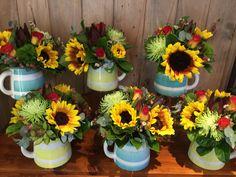 Sunflower milk jugs, for a Melbourne Cup day funtion at QT Hotel, designed by Twigs Florist Varsity Lakes Corporate Flowers, Melbourne Cup, Table Arrangements, Planter Pots, Floral Wreath, Milk Jugs, Wreaths, Lakes, Design