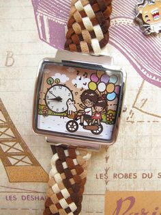 Hand painted watch with girl and boy riding bike with by NaniWatch, $40.00