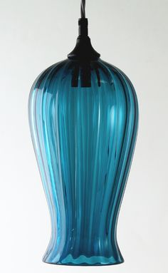 This range reveals the pure elegance and simplicity of handmade glass by harnessing the natural fluidity of the material. During the production process the glass is skillfully allowed to stretch whilst being blown into the final shape. Lanterns, Range, Shapes, Pure Products, Lights, Elegant, Natural, Glass, Handmade