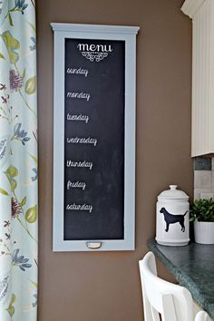 IHeart Organizing's weekly menu board from an old kitchen cabinet door!  I will be making this one for sure!  I love the handle to hold the chalk - genius!