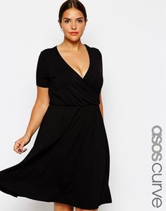 A great basic black swing dress - accessorize down for day or up for night - ASOS CURVE Wrap Front  Skater Dress
