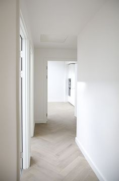 White Linen Walls & Pale Lime Wash Fishbone Flooring: