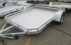 New 2016 Aluma Single Axle Utilities 7710 Snowmobile For Sale in Wisconsin,WI. 2016 Aluma Single Axle Utilities 7710, 2016 Aluma Single Axle Utilities 7710 <p>Aluma is the most complete aluminum utility & recreational trailer line in America we have utility trailers, ATV trailers, open and enclosed snowmobile trailers, open and enclosed motorcycle trailers, personal water craft trailers, car haulers and truck beds with headache racks. We are always adding new models to our line up. Aluma…
