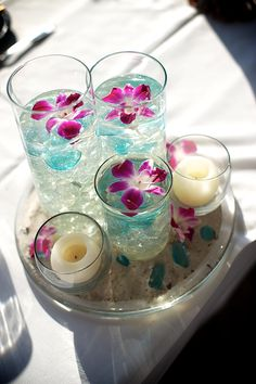 Sand Petal Weddings offers the convenient rental service of beach style centerpieces for ease to the traveling destination bride. Beach Wedding Reception, Wedding Reception Centerpieces, Table Centerpieces, Anniversary Decorations, Retirement Parties, Center Pieces, Orchid, Mason Jars, Dream Wedding